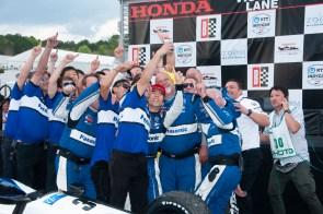 Takuma Sato and his crew celebrate after winning the 2019 Honda Indy Grand Prix of Alabama at Barber Motorsports Park. (Billy Brown/Alabama NewsCenter)