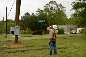 An Alabama Power lineman checks out a new utility pole on Friday following Thursday night's storm. (Phil Free/Alabama NewsCenter)