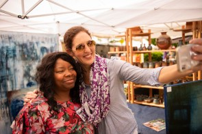 Myrna Gates. left, takes a selfie with Brooke Fleming at Magic City Art Connection. (Phil Free / Alabama NewsCenter)