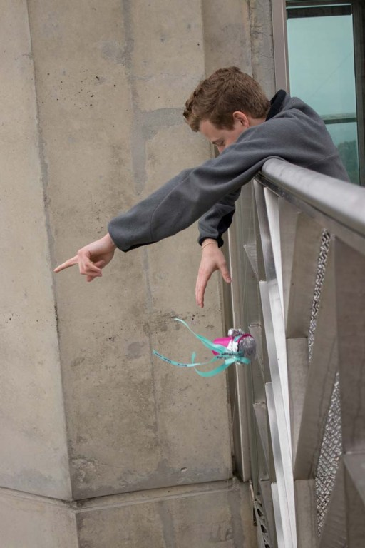 A UAB engineering student drops an egg 100-plus feet inside an apparatus built for this year's egg drop contest organized by the University of Alabama at Birmingham School of Engineering. (Dennis Washington/Alabama NewsCenter)