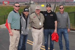 "NASCAR drivers Jeffrey Earnhardt (second from left) and Chase Briscoe (second from right) joined Talladega Superspeedway Chairman Grant Lynch (center), and Lance Taylor (far right) and Ellis Bennett (far left) from Taylor Corporation, who spearheaded the tunnel construction efforts, in the ribbon-cutting ceremony on Wednesday as part of the ""official"" Grand Opening for fans to enter the track's iconic infield. (contributed)"
