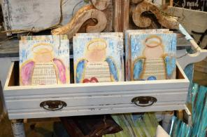 Southern Boys Woodworks turns reclaimed wood into home decor items, often with Christian words and images. (Michael Tomberlin / Alabama NewsCenter)