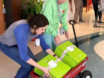 Volunteers from Alabama Power Service Organization, Regions, Greystone Golf and Country Club and Edgar's Bakery teamed with Cheeriodicals to pack and deliver gift boxes to mothers and children at Children's of Alabama on Mother's Day. (Michael Tomberlin / Alabama NewsCenter)