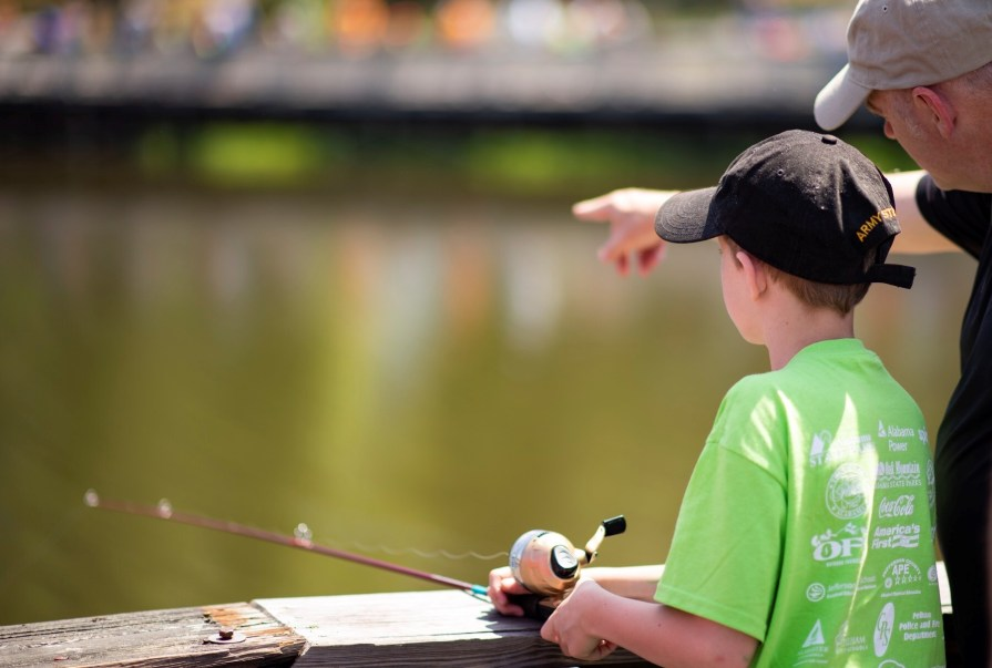 Alabama Power volunteers help special-needs children learn to fish at the annual Gone Fishin' Not Just Wishin' event. (Phil Free/Alabama NewsCenter)