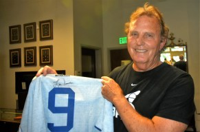 Irondale's Mike Eady shows his Piniella-signed Royals jersey. (Solomon Crenshaw Jr./Alabama NewsCenter)