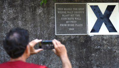Richard Kaley of Mobile snaps a photo of the plaque on the original outfield wall at Rickwood Field. (Solomon Crenshaw Jr./Alabama NewsCenter)