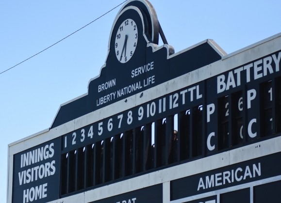 The old-style manual scoreboard at Rickwood Field keeps the volunteers behind it on their toes. (Solomon Crenshaw Jr./Alabama NewsCenter)