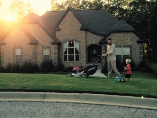 Shultz mows with his son, Pierce. (contributed)