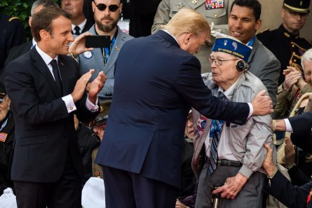 Emmanuel Macron, France's president, left, and U.S. President Donald Trump, meet World War II veterans during a ceremony at the Normandy American Cemetery and Memorial in Colleville-sur-Mer, France, on Thursday, June 6, 2019, the 75th anniversary of the D-Day landings. (Geert Vanden Wijngaert/Bloomberg)