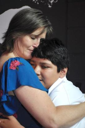 Nancy Kurre revels in an embrace with her son Xavier. (Karim Shamsi-Basha / Alabama NewsCenter)