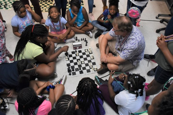 Students at BSI learn to play chess. (Dury Shamsi-Basha/Alabama NewsCenter)