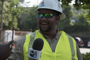 Alabama Power lineman holds the ABC 33/40 microphone. (Brittany Faush)