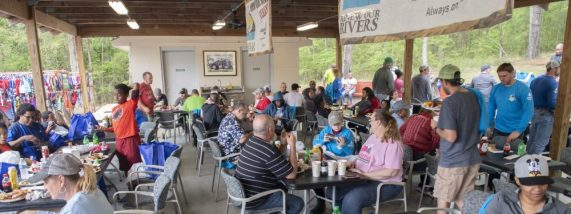 After the cleanup, volunteers and organizers enjoy lunch. (file)