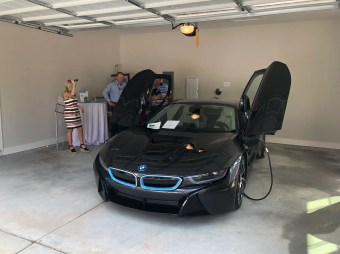 An electric car is on display in the garage of the first Northwoods Smart Neighborhood® home in Auburn. (contributed)