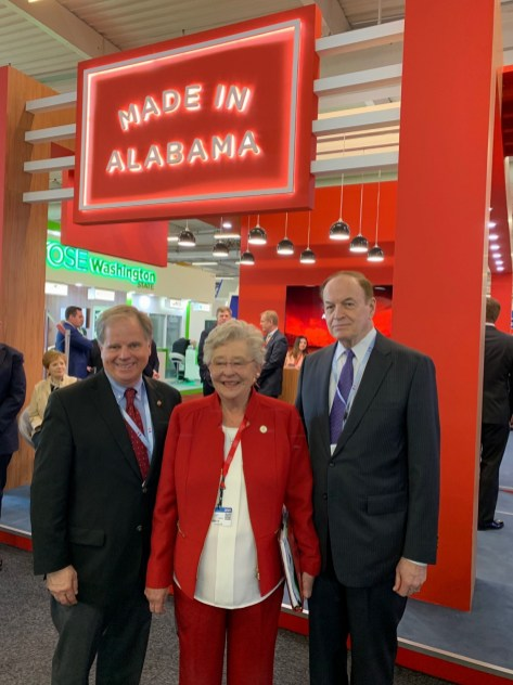 U.S. Sens. Doug Jones and Richard Shelby stop at the Made in Alabama booth at the Paris Air Show to speak with Gov. Kay Ivey. (contributed)