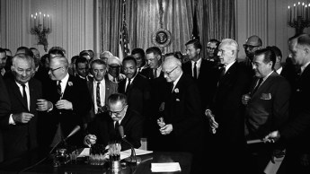 President Lyndon B. Johnson signs the 1964 Civil Rights Act, July 2, 1964. (Cecil Stoughton, White House Press Office, Wikipedia)