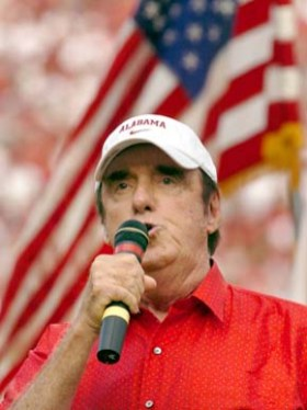 "Sylacauga native Jim Nabors (1930- ) sings the national anthem before the University of Alabama football game against the University of Hawaii at Bryant-Denny Stadium in Tuscaloosa in September 2006. The actor and vocalist is best known for his role as Gomer Pyle on ""The Andy Griffith Show"" and ""Gomer Pyle, USMC."" (From Encyclopedia of Alabama, courtesy of The Huntsville Times)"
