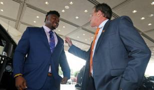 Auburn coach Gus Malzahn fixes the lapel of Prince Tega Wanogho at SEC Media Days. (Todd Van Emst/AU Athletics)