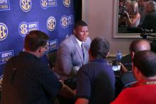 Derrick Brown answers questions from reporters at SEC Media Days in Hoover. (Bruce Nix / Alabama NewsCenter)