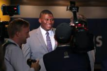 Derrick Brown smiles during questioning from reporters at SEC Media Days in Hoover. (Bruce Nix / Alabama NewsCenter)