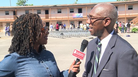 Roderick Royal speaks with Keisa Sharpe-Jefferson at the site of the historic A.G. Gaston Motel. (Dennis Washington / Alabama NewsCenter)