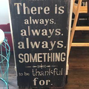 Encouraging sayings abound at WE Cafe. (Keisa Sharpe)