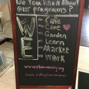 This sign shows all WE Cafe and Urban Ministry offers. (Keisa Sharpe)