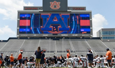 Auburn coach Gus Malzahn talks to his team following practice. (Todd Van Emst/AU Athletics)