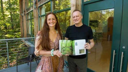 "Carlee Sanford and Mark Kelly hold a copy of Kelly's new book, ""Back to Nature."" (Dennis Washington / Alabama NewsCenter)"