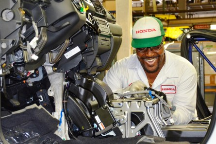 An employee at Honda's facility in Lincoln assembles a Honda Pilot. (contributed)