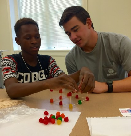 Summer intern David Petrey works with one of the children during the Summer Seed Camp. (CBF Alabama)