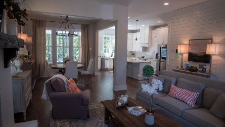 The den and kitchen of the model home. (Dennis Washington / Alabama NewsCenter)