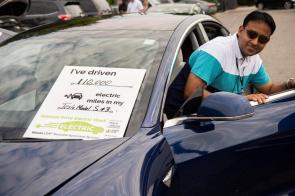 Electric vehicle owners talk about the advantages of ownership at the Market at Pepper Place during 2019 National Drive Electric Week. (Phil Free / Alabama NewsCenter)