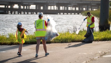 Employees of Alabama Power, along with their families, volunteer their time to help pick up trash during the Alabama Coastal Cleanup. (Dennis Washington / Alabama NewsCenter)