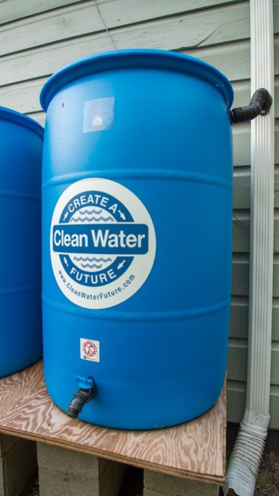 A 55-gallon drum installed at a home Prichard to catch rain water. (Dennis Washington / Alabama NewsCenter)
