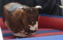 A bucking bull ride is among the attractions outside the stadium at the Magic City Classic. (Solomon Crenshaw Jr. / Alabama NewsCenter)