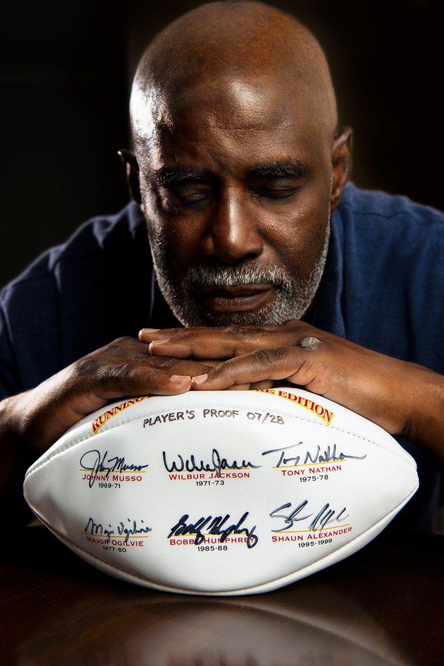 A football features the names and signatures of six great Alabama running backs, including Wilbur Jackson. (Phil Free/Powergrams)