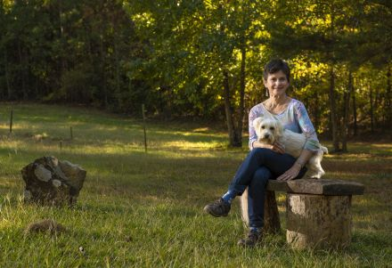 Taking a breather, Cook and Oscar enjoy the backyard. (Phil Free/Alabama NewsCenter)