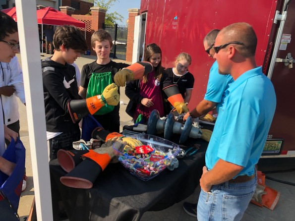 Eighth-graders try out some Alabama Power lineman gear at the Central Alabama Career Discovery Expo. (Alabama NewsCenter)