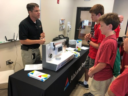 An Alabama Power representative talks with students at the Central Alabama Career Discovery Expo. (Alabama NewsCenter)