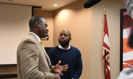 "Jermain ""Funnymaine"" Johnson interviews ASU coach Donald Hill-Eley. (Solomon Crenshaw Jr. / Alabama NewsCenter)"