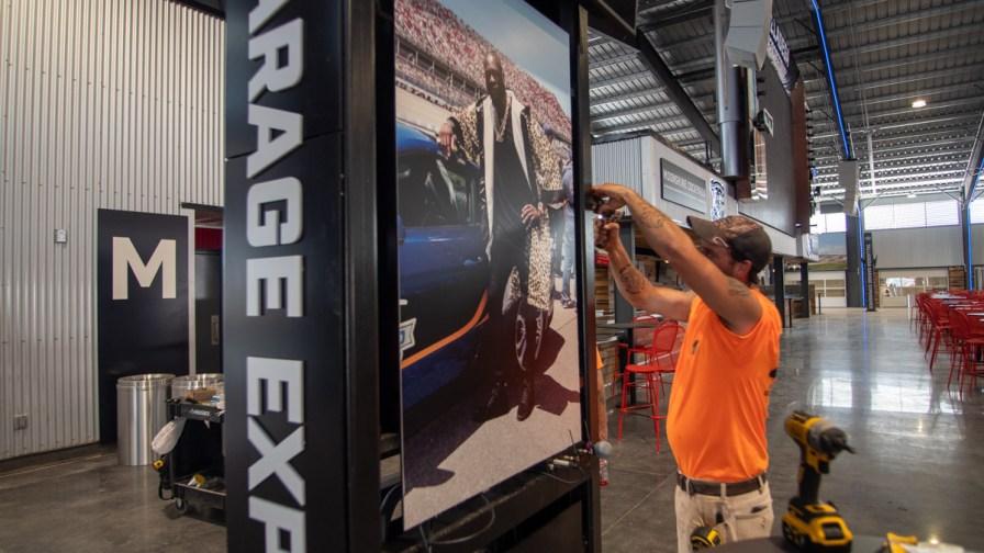 Crews put the final touches on the new Talladega Garage Experience. (Dennis Washington / Alabama NewsCenter)