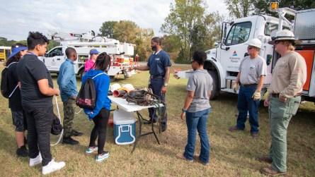 Linemen from Alabama Power demonstrate some of their safety gear. (Dennis Washington / Alabama NewsCenter)