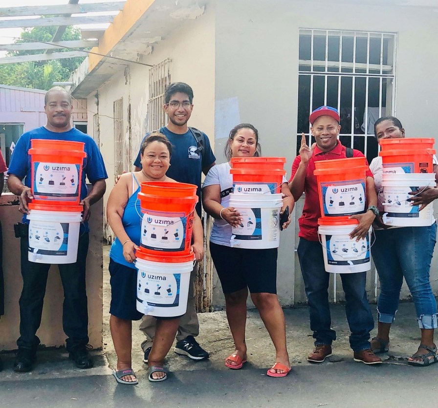 Shawn Goyal distributes water filtration systems to household in Puerto Rico. (contributed)