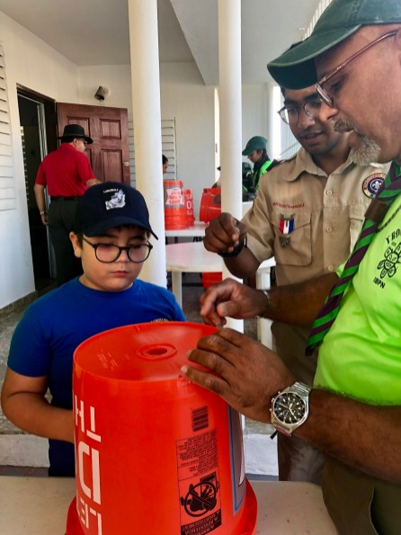Shawn Goyal works with Scouts in Puerto Rico to assemble Uzima water filters to distribute to families without clean water. (contributed)