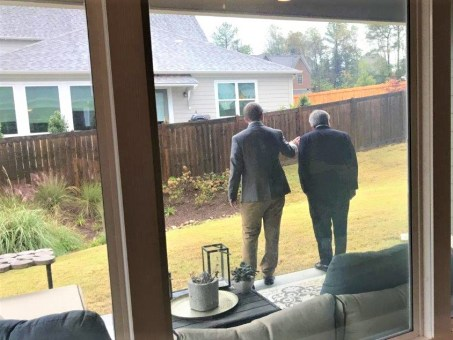 Southern Company Research and Development's Jim Leverette, left, leads Deputy Energy Secretary Dan Brouillette on a tour of Alabama Power's Smart Home in Reynolds Landing. (Michael Sznajderman / Alabama NewsCenter)
