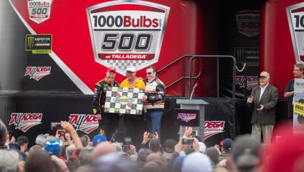 Richard Childress presents Grant Lynch a gift signed by all the drivers participating in Sunday's 1000Bulbs.com 500. (Dennis Washington / Alabama NewsCenter)