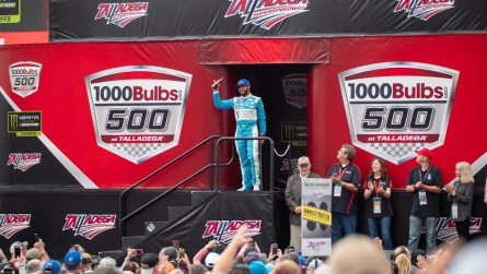 Mobile native Bubba Wallace waves to the crowd during driver introductions prior to the start of Sunday's 1000Bulbs.com 500. (Dennis Washington / Alabama NewsCenter)