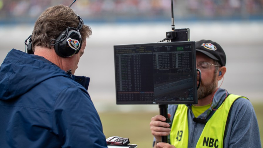 A reporter for NBC Sports Network prepares to go live during the broadcast of Sunday's race. (Dennis Washington / Alabama NewsCenter)