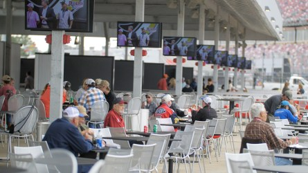 Fans relax and enjoy refreshments in the new Pit Road Club inside the Talladega Garage Experience. (Dennis Washington / Alabama NewsCenter)